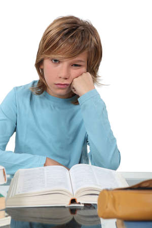 A bored child studying Stock Photo - 13459462