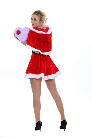 wrapped present: Pretty blonde in a short Santa costume