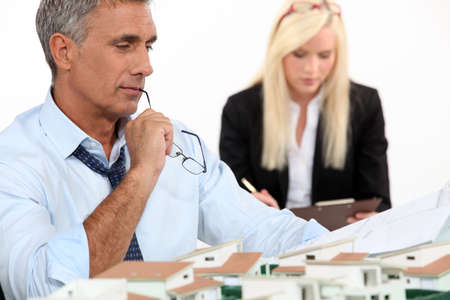 Architect with plans and 3D model Stock Photo - 13459399