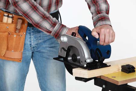 manufactory: Mason using circular saw
