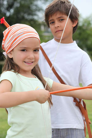 Children with bow and arrow photo