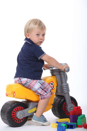 Boy on a toy motorbike Stock Photo - 13460097