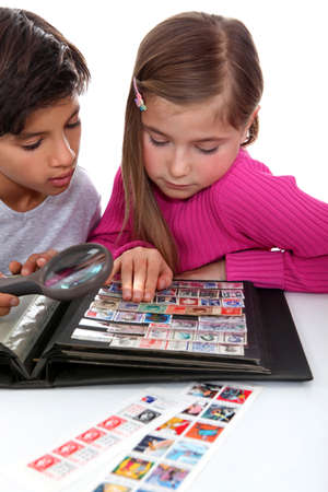 stamp collecting: Kids collecting stamps