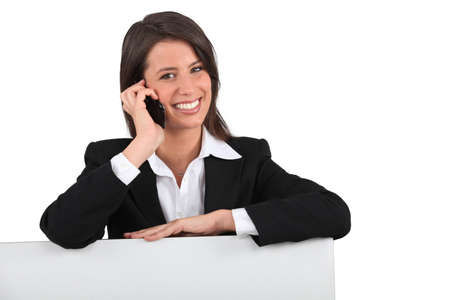 Smiling woman on the phone Stock Photo - 13461388
