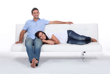 Couple on white sofa photo