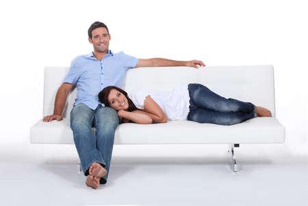 drowsiness: Couple on white sofa