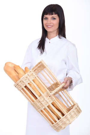 Baker with basket of bread photo