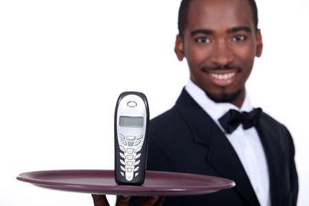 telephony: black waiter showing a phone