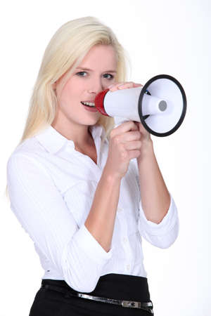 Blond woman speaking into megaphone photo