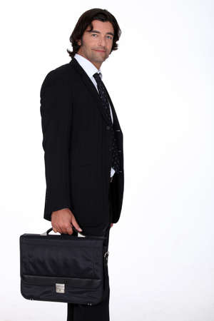 45 50 years: Portrait of a businessman carrying a briefcase