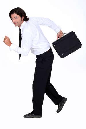 fleeing: Businessman fleeing