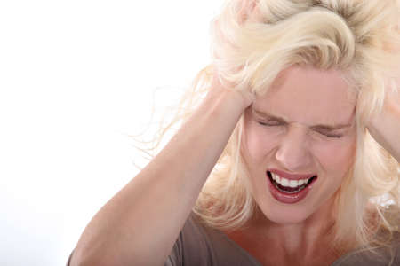 mouth closed: Young blonde pulling her hair