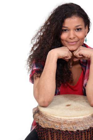 bongo drum: Woman sat with bongo Stock Photo