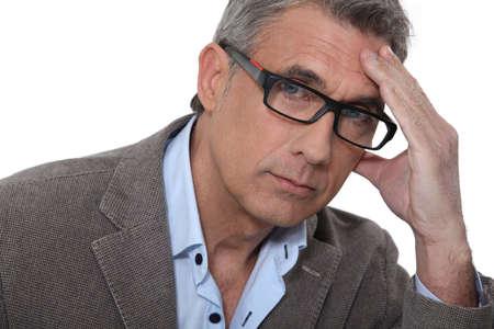 urging: Man with headache Stock Photo