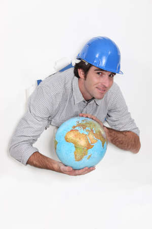 Manual worker holding globe Stock Photo - 13459175