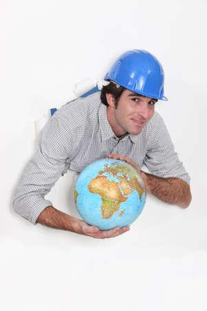 Manual worker holding globe Stock Photo - 13459175