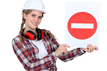 tradesperson: Traffic guard holding a no entry sign