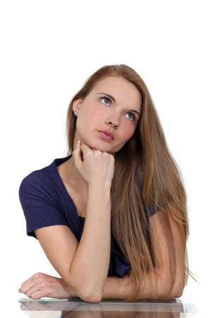hand on chin: pensive young woman Stock Photo