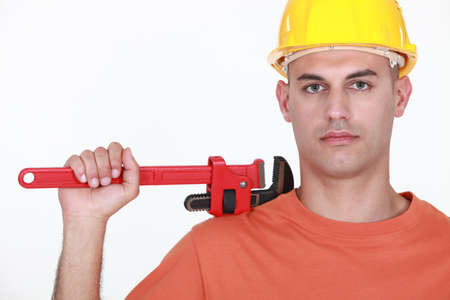 Man with an adjustable wrench Stock Photo - 13459238