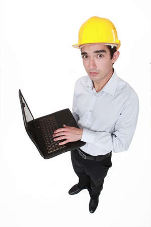 Worried engineer holding a laptop photo