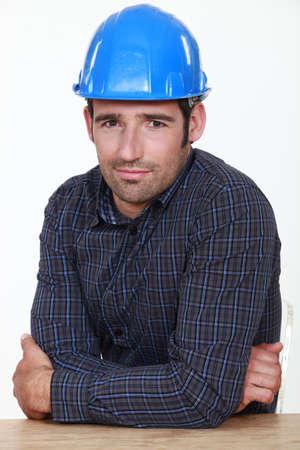 awkwardness: Portrait of an uneasy tradesman