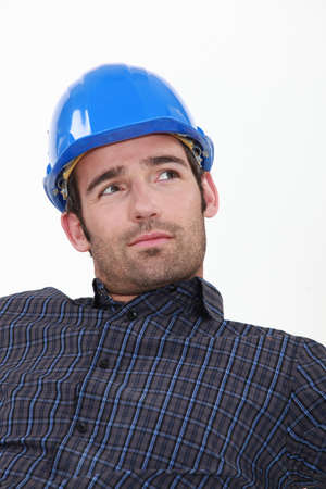 settle back: Attractive man in a hardhat