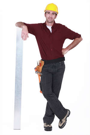 nonchalant: Tradesman leaning against a girder Stock Photo