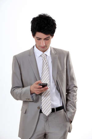 businessman reading sms Stock Photo - 13459060