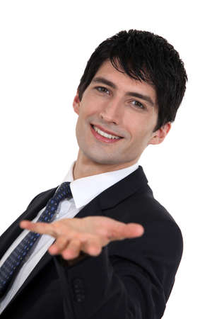 businessman giving a wide open hand photo