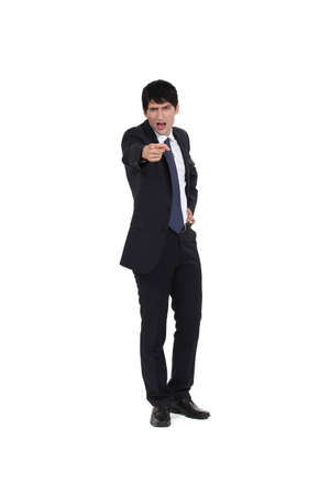 incriminate: Businessman angrily pointing his finger Stock Photo
