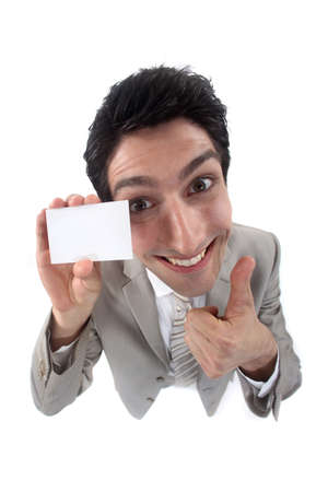 Businessman holding up his business card photo