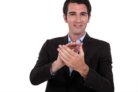 40 45: Businessman clapping his hands