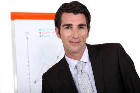 40 45: Businessman standing next to a flip chart Stock Photo