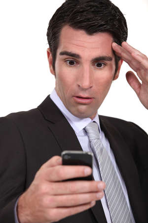 stunned: Stunned businessman reading a text message