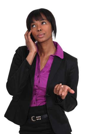 Woman negotiating via mobile telephone photo