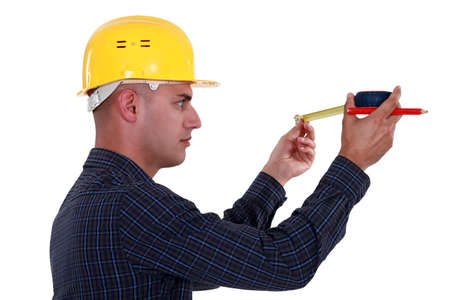 Man watching his measuring tape photo