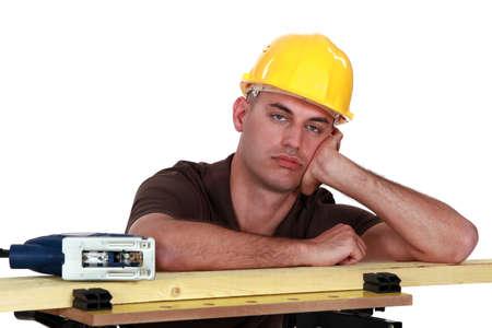 A bored carpenter  photo