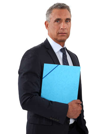50 to 55 years: Businessman holding a blue folder