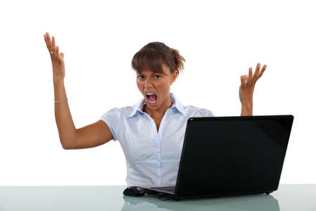Woman frustrated with her laptop photo