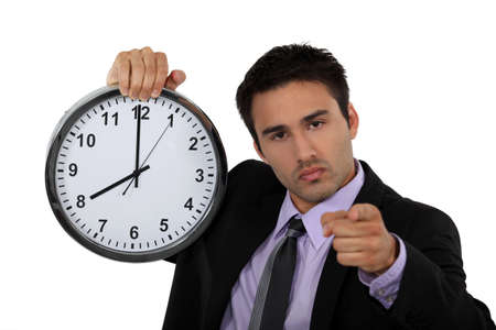 young businessman holding a clock photo