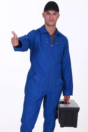non verbal communication: Handyman giving the thumb