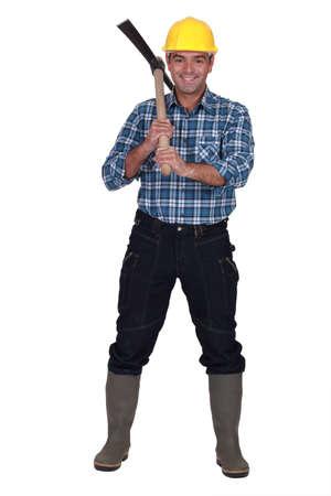 ax man: Man wielding ax Stock Photo