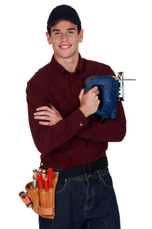 Worker with an electric jigsaw photo