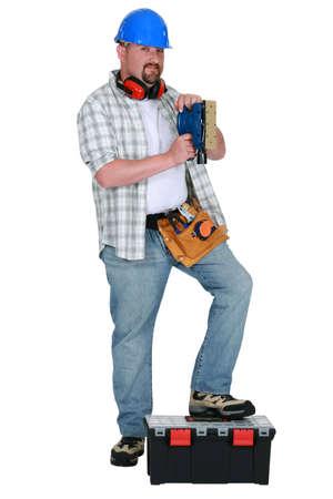 Man using power sander Stock Photo - 13460136