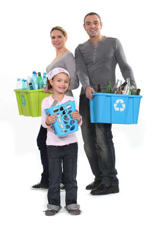 Family sorting garbage, studio shot photo