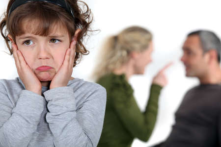 tantrum: Little girl listening to parents argue Stock Photo