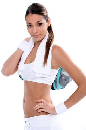 Attractive brunette carrying gym bag Stock Photo - 13459548