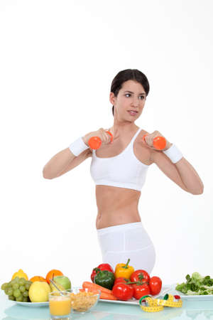 healthily: Woman keeping fit and eating healthily