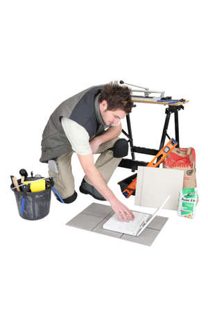 Tile cutter with laptop Stock Photo - 13500206