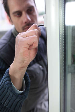 Man fitting a new window photo